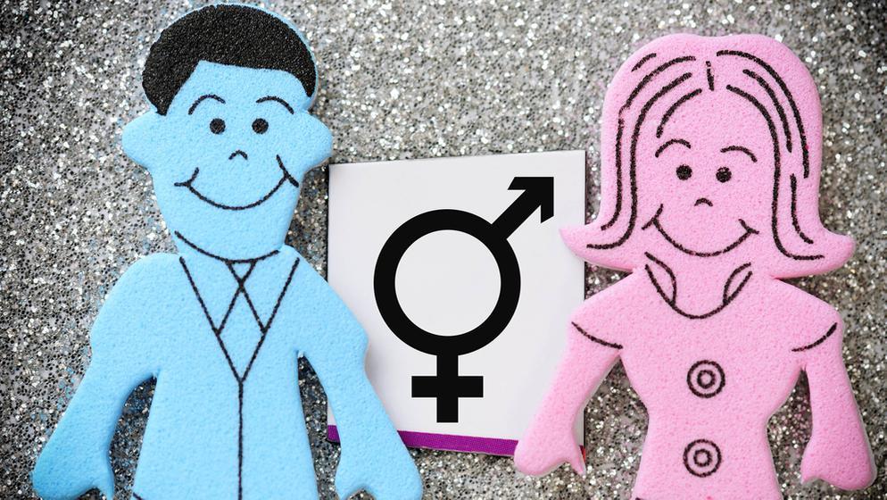 Figuren von Mann und Frau mit intersexuellem Geschlechterzeichen | Bild:picture alliance/Bildagentur-online