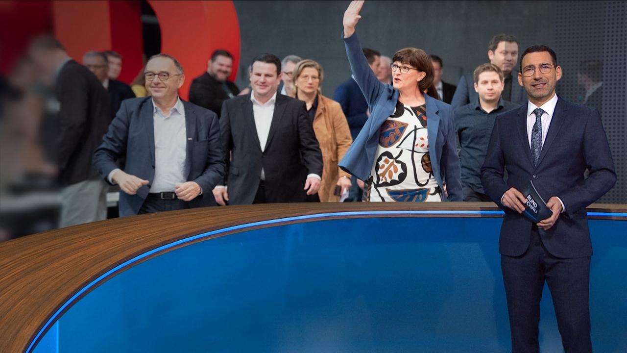 Moderator Till Nassif vor einem Bild des SPD-Parteitags