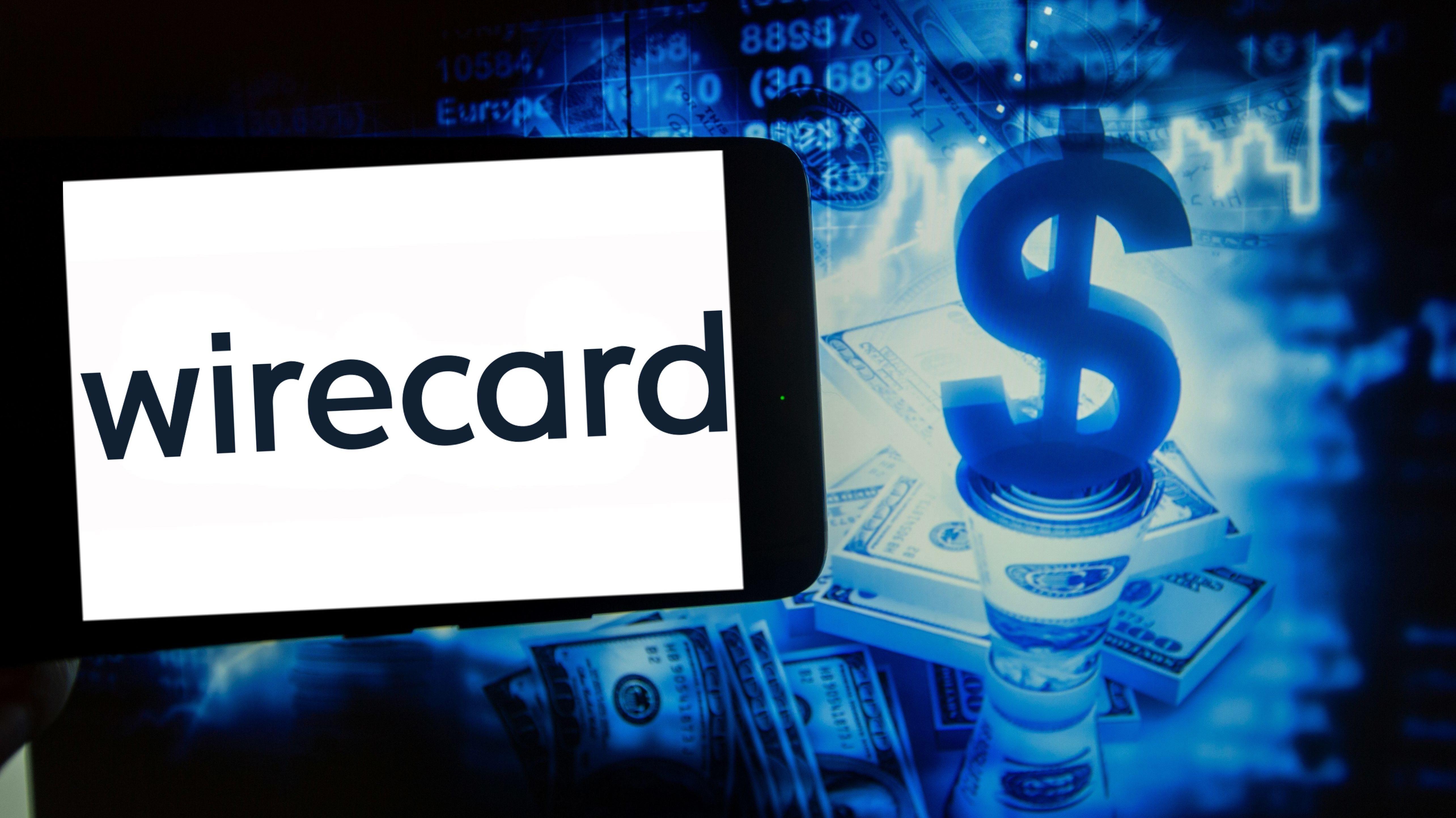 Das Logo von Wirecard - im Hintergrund ein Dollar-Zeichen