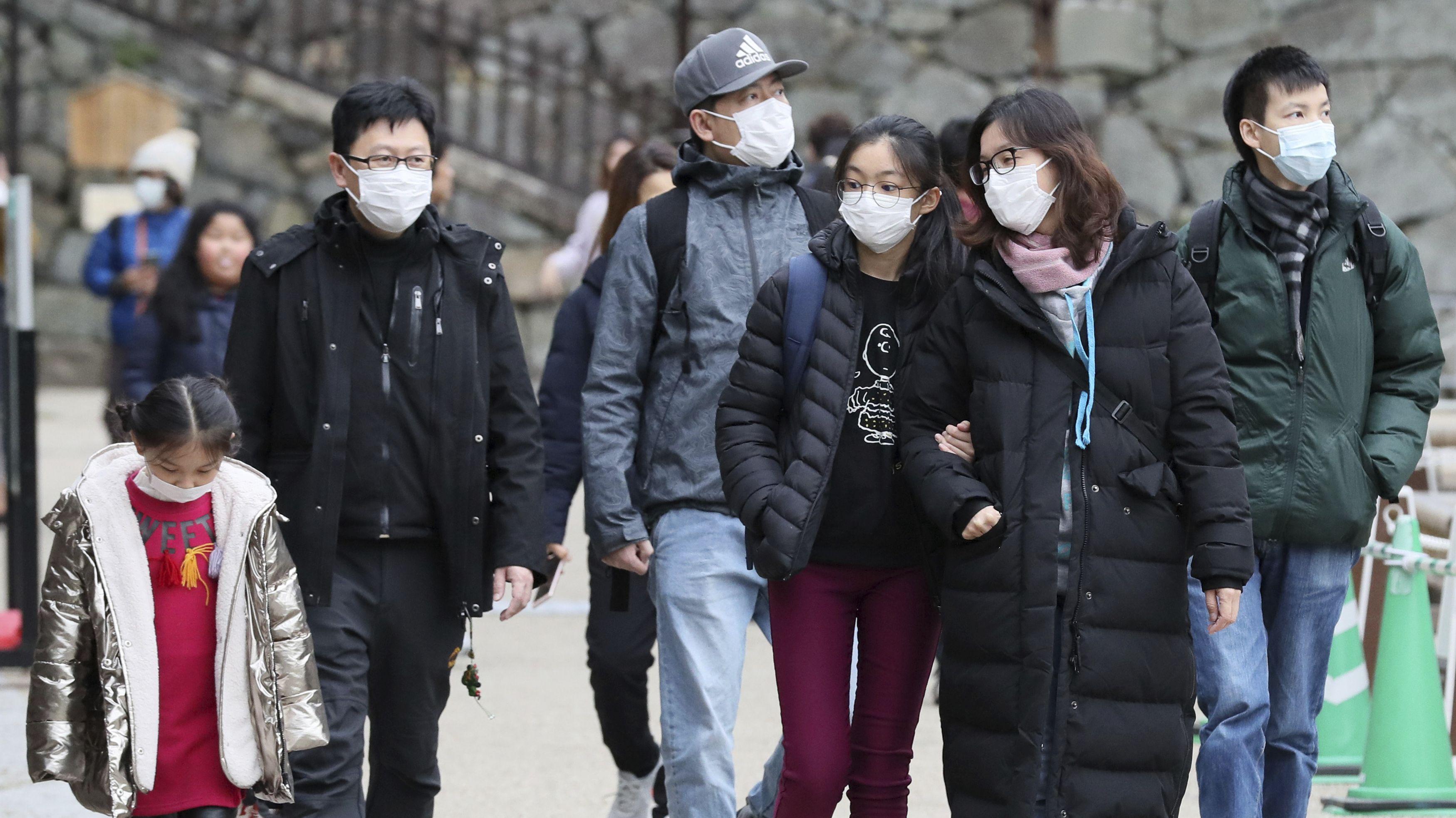 Touristen mit Mundschutz in Nagoya.