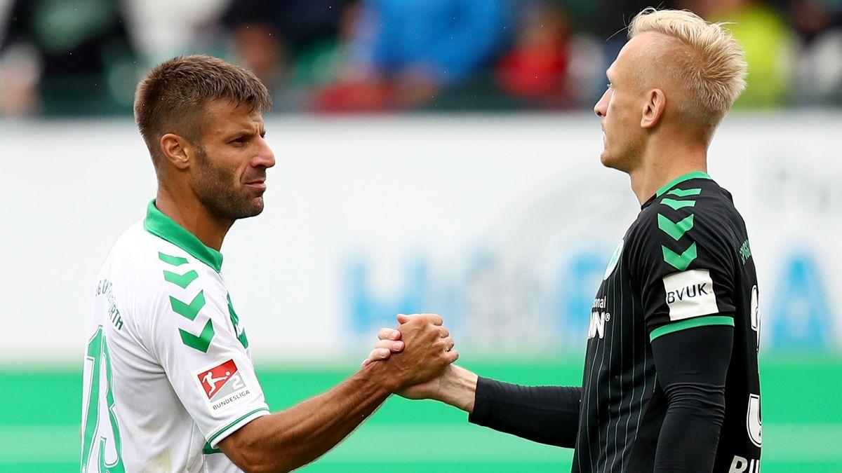 Fürths Kapitän Marco Caligiuri (li.) und Torhüter Sascha Burchert