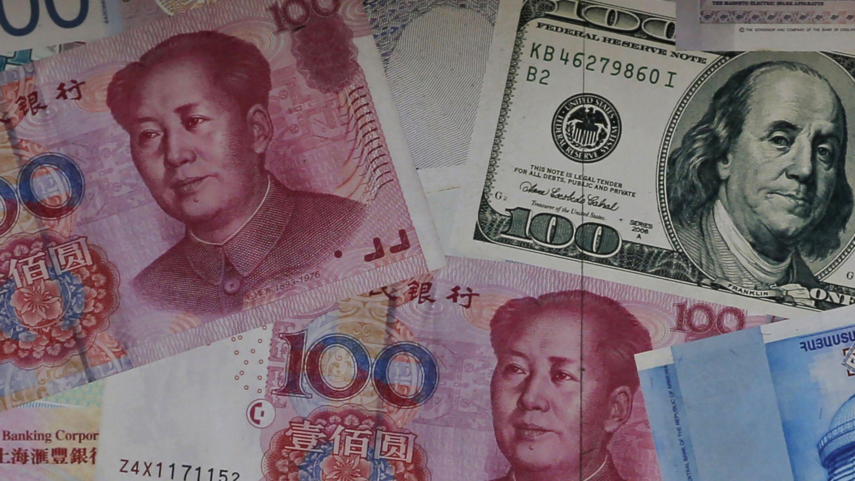 Yuan und US-Dollar Scheine (Symbolbild)