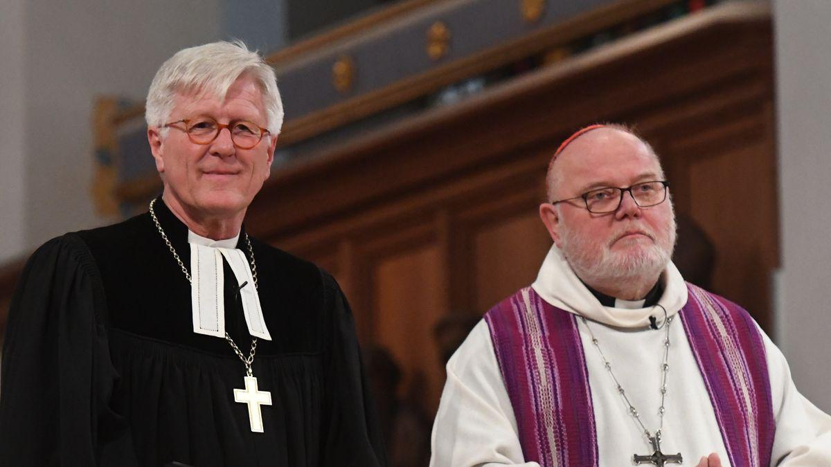 Der EKD-Ratsvorsitzende Heinrich Bedford-Strohm (l.) und Kardinal Reinhard Marx (Archivbild)