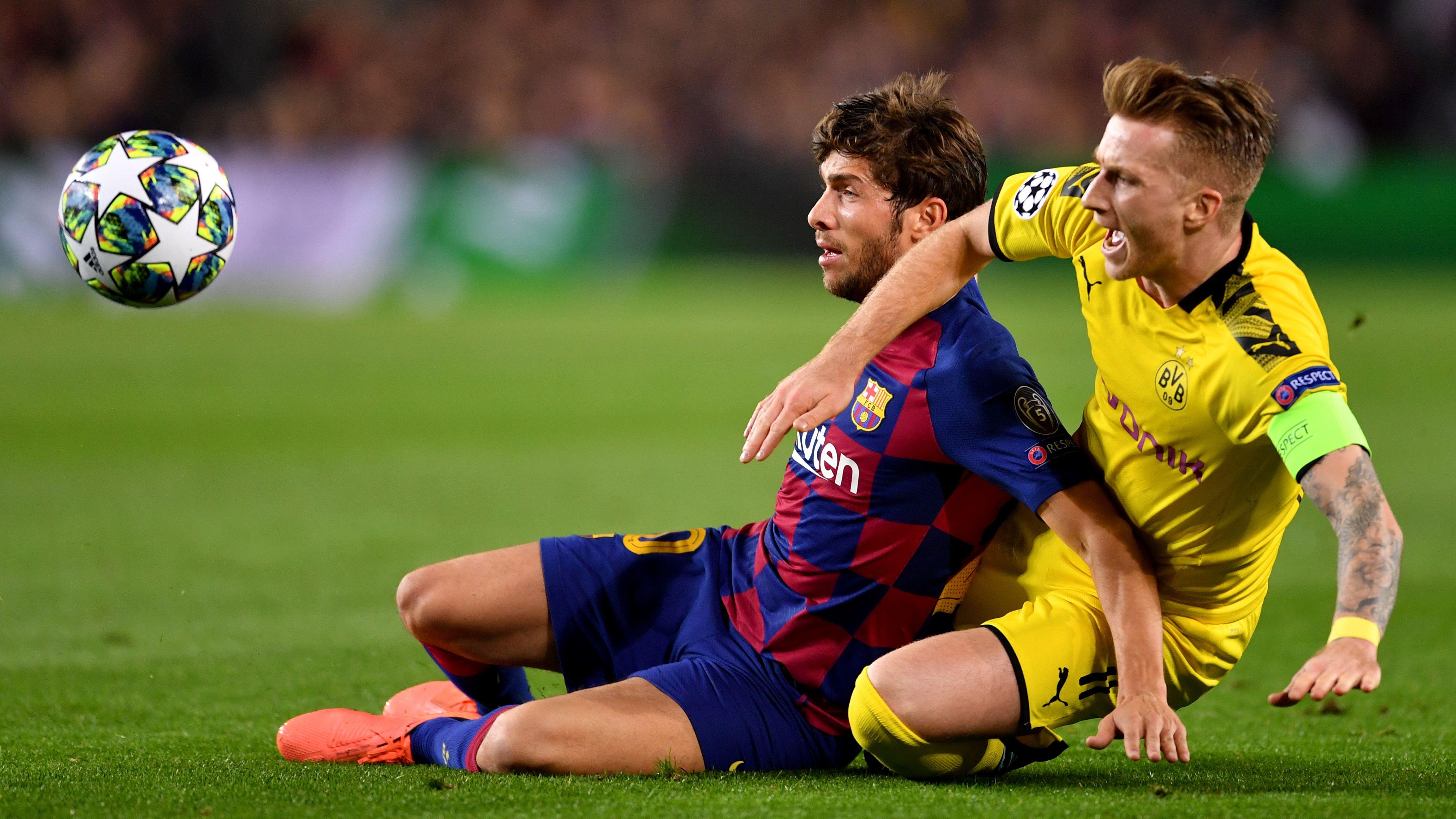 Barcelonas Sergi Roberto (l.) und Dortmunds Marco Reus