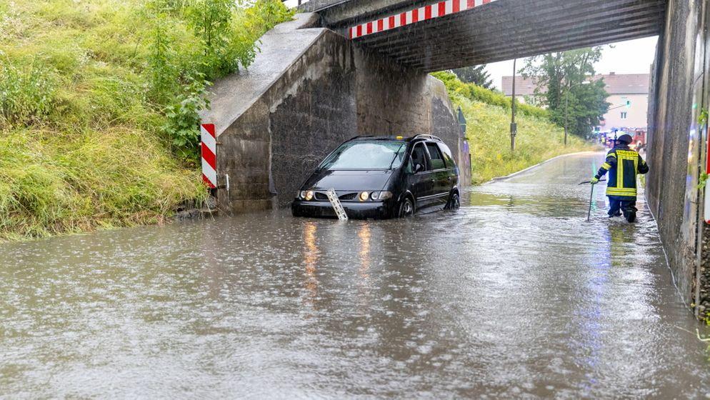 Überflutete Straße im Kreis Traunstein | Bild:FDL/BeMi