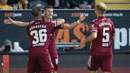 Nürnberger Spieler feiern das 1:0 von Tom Krauß (Mitte) in Dresden   Bild:picture-alliance/dpa
