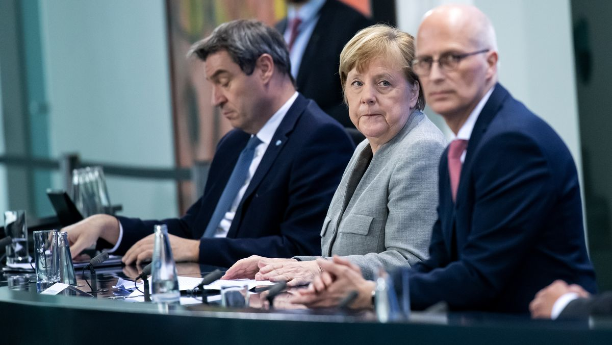 Markus Söder, Angela Merkel and Peter Tschentscher at the press conference