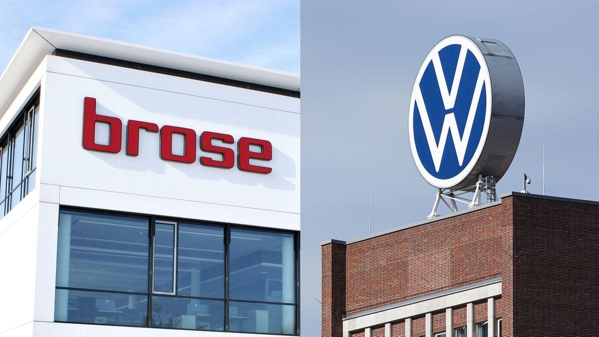 """Ein weißes Gebäude mit der roten Aufschrift """"Brose"""" und ein roter Klinkerbau mit dem weiß-blauen Logo """"VW"""" auf dem Dach."""