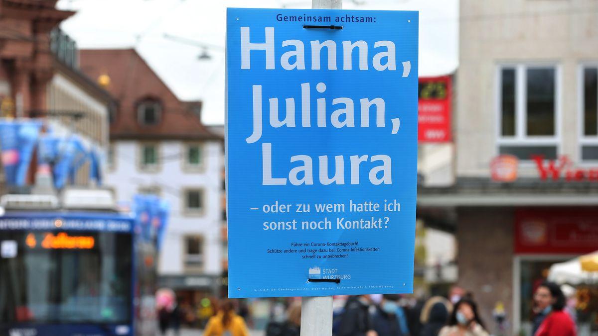 Schild in Würzburg soll Menschen erinnern, zu wem sie Kontakt hatten.
