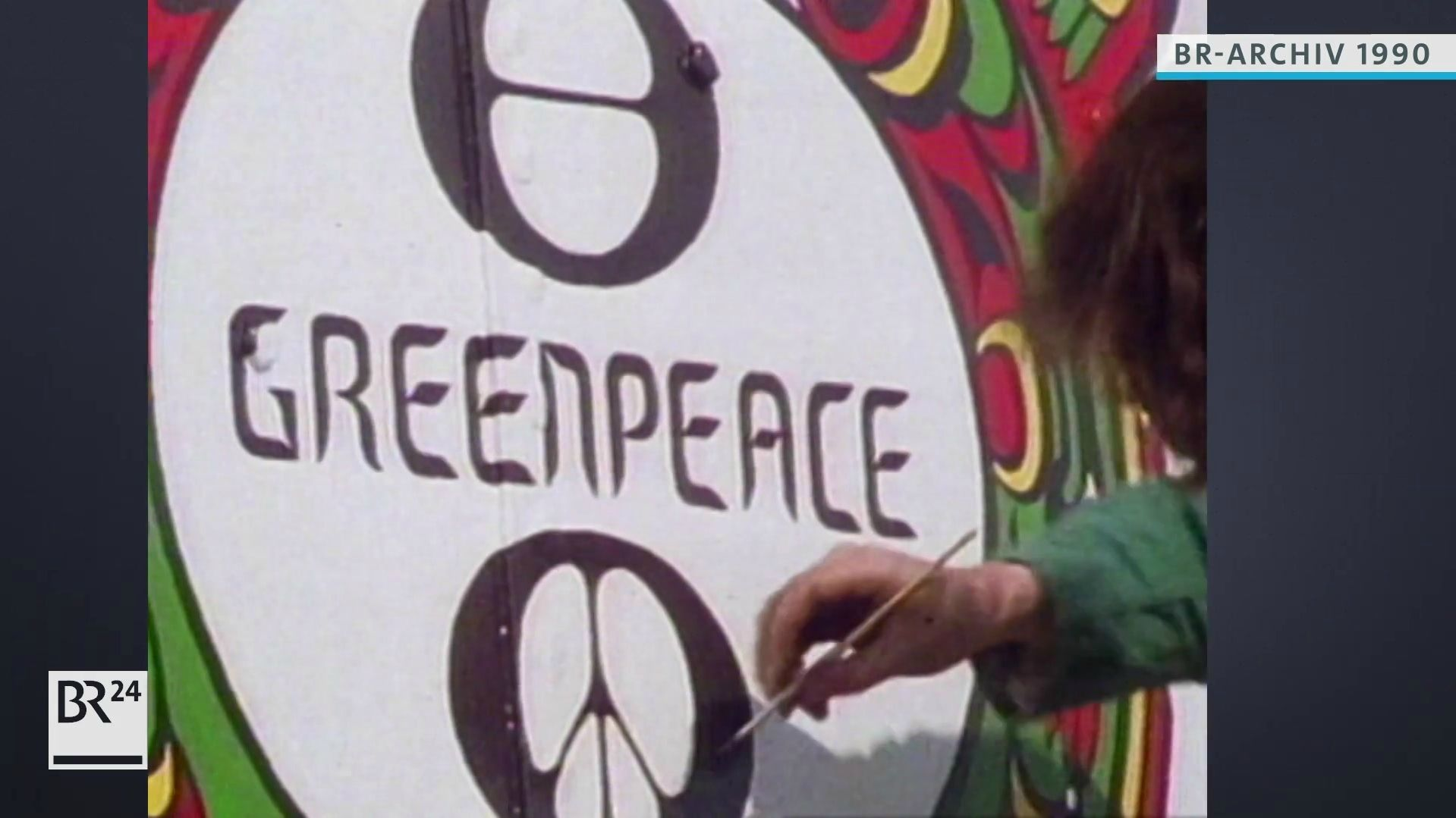 Malen eines Greenpeace-Logos