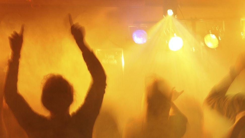 Symbolbild Diskokugel - Tanzende