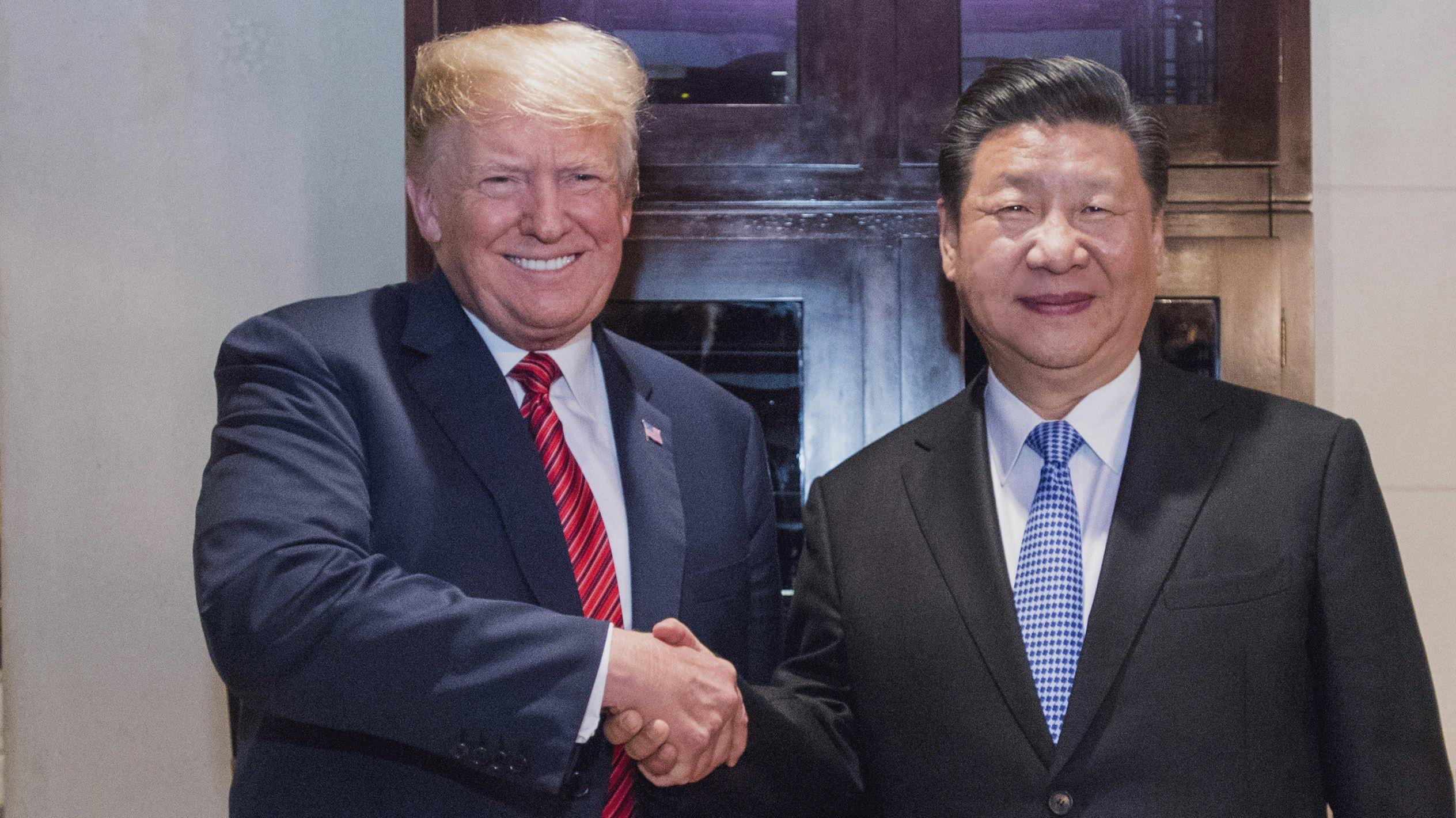 Donald Trump (li.) und Xi Jinping