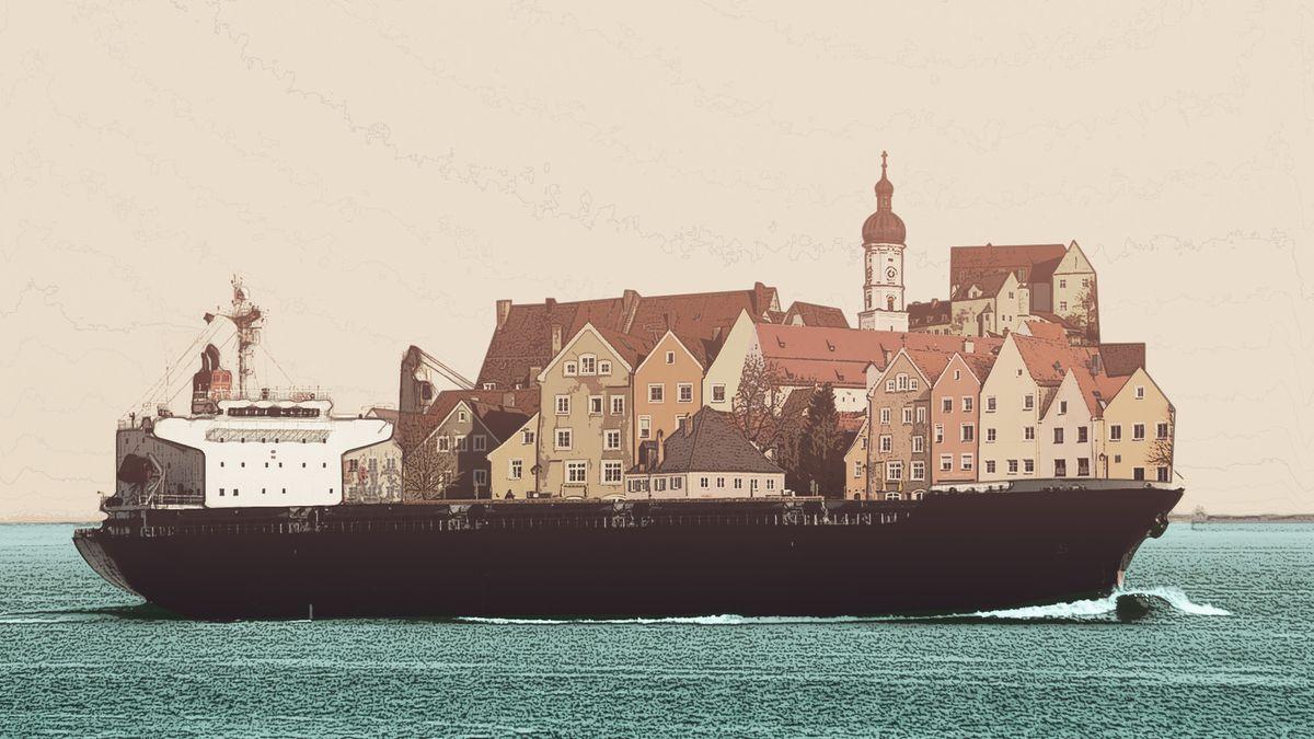 Ein Frachtschiff, das viele kleine, bunte Häuser transportiert