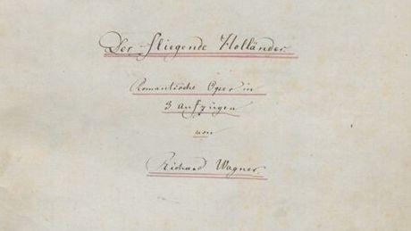 """""""Der Fliegende Holländer, Romantische Oper in 3 Aufzügen von Richard Wagner"""" ist in blasser Handschrift auf dem Deckblatt der Partitur zu lesen."""