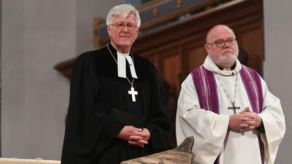 So reagieren die Träger des diesjährigen Augsburger Friedenspreises, Landesbischof Bedford-Strohm und Kardinal Marx, auf die Auszeichnung.