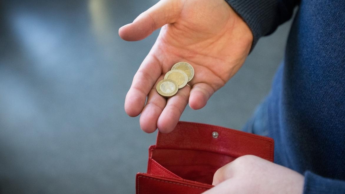 Geld und Portemonnaie