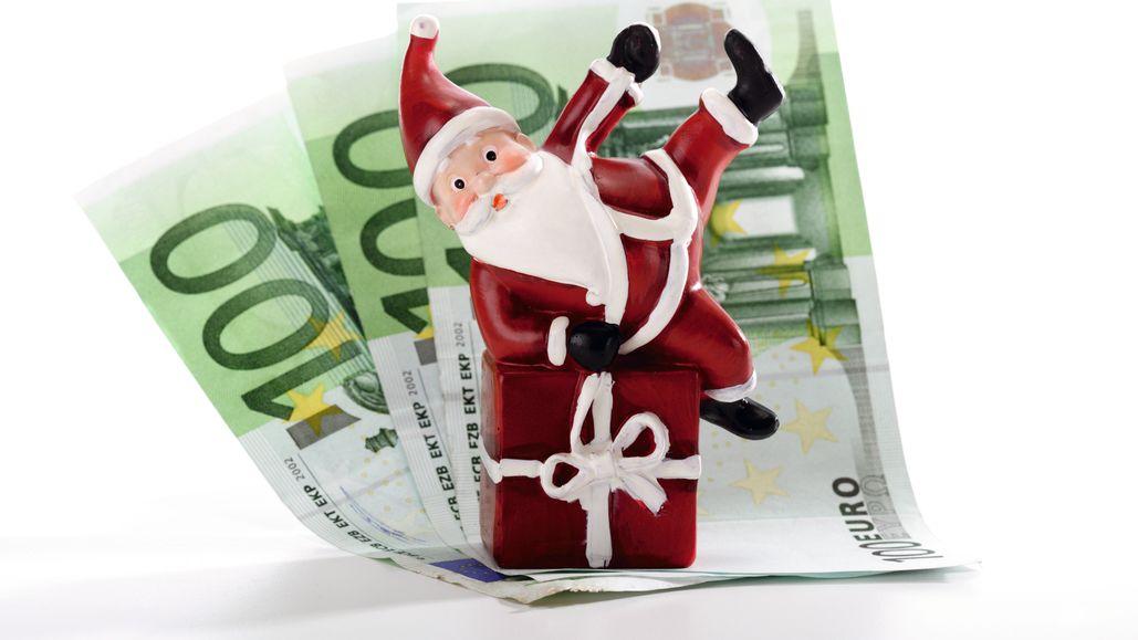 Weihnachtsmann und Geldscheine