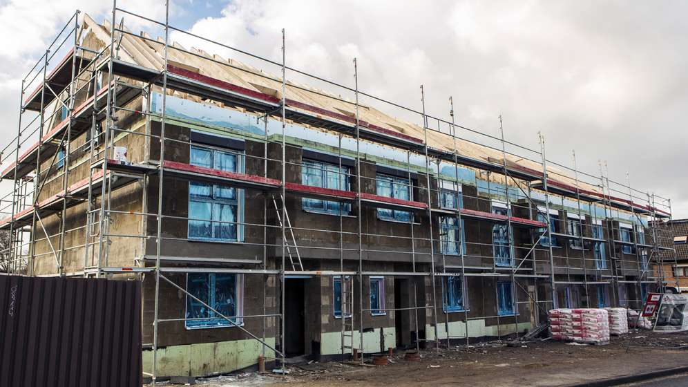Baustelle von Mehrfamilienhäusern | Bild:picture alliance