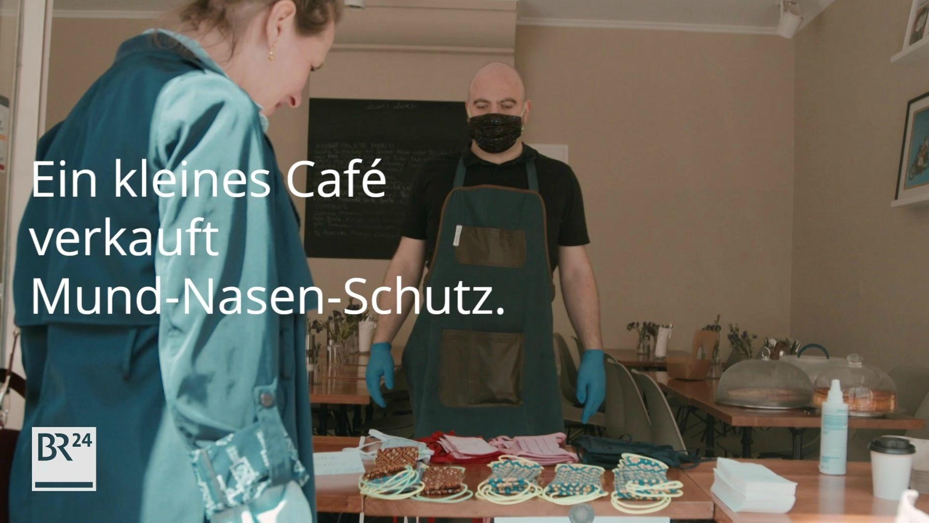 Ein kleines Café verkauft Mund-Nasen-schutz