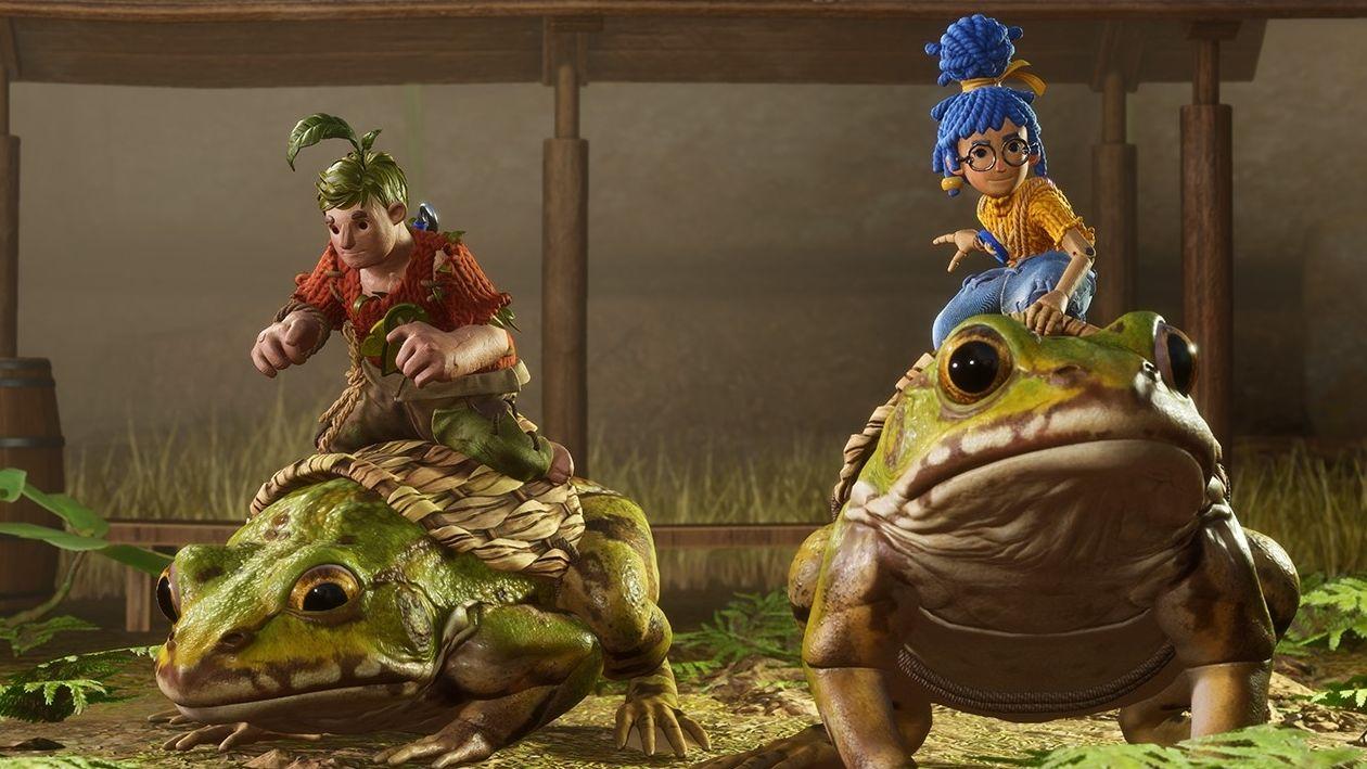 """Szene aus dem Spiel """"It Takes Two"""". Die beiden Spielfiguren reiten auf Kröten."""