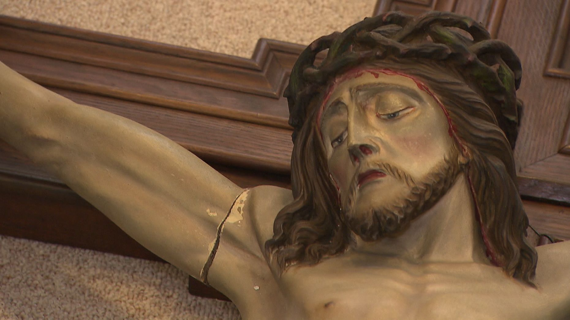 Beschädigte Christusfigur