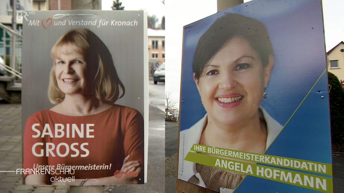 Zwei Wahlplakate zeigen die beiden Kandidatinnen zur Bürgermeisterwahl, Sabine Gross und Angela Hofmann.