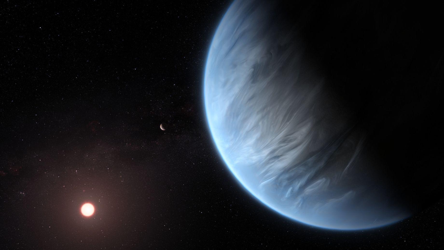 Die vom University College London Centre for Space Exochemistry Data Research zur Verfügung gestellte Darstellung eines Künstlers zeigt den Exoplanet K2-18b (r) und seinen Gaststern (l) und einen begleitenden Planeten in diesem System.