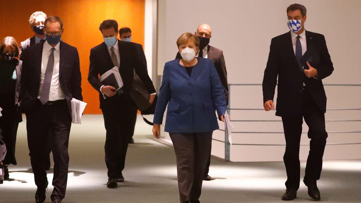 Archivbild: Bundeskanzlerin Merkel (CDU), Bayerns Ministerpräsident Söder (CSU) und Berlins Regierender Bürgermeister Müller (SPD)