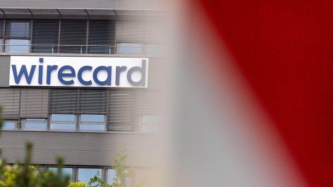 München: Der Schriftzug der insolventen Firma Wirecard hängt an der Fassade der damaligen Zentrale des Unternehmens in Aschheim bei München.