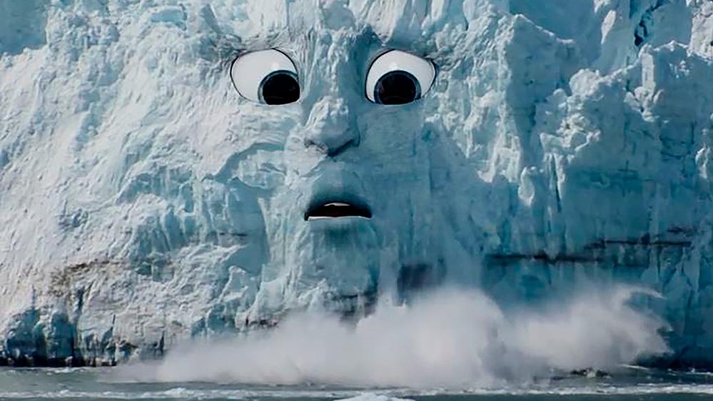 """Animation aus """"Earth Speakr"""": Gesicht mit weit geöffneten Augen und geöffnetem Mund in einem Eisberg, von dem Stücke abbrechen"""