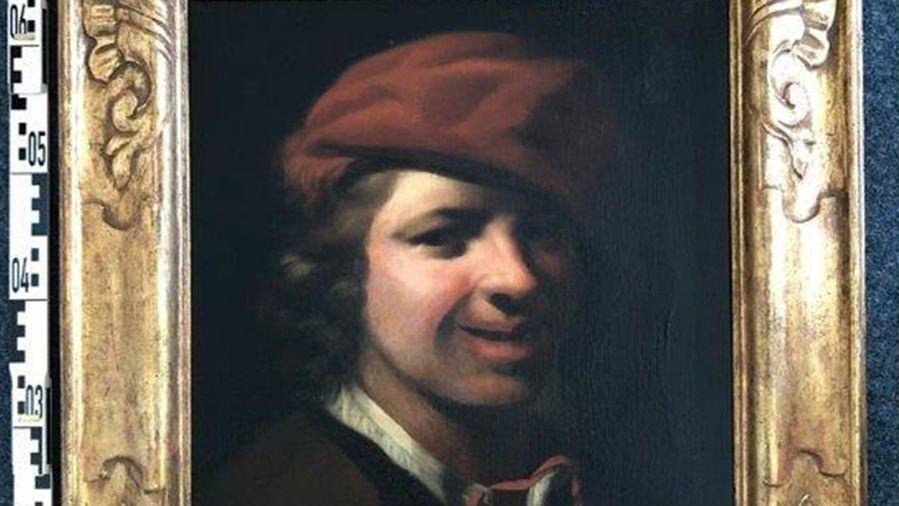 Ölgemälde eines jungen Mannes mit Locken und roter Mütze in einem Goldrahmen.
