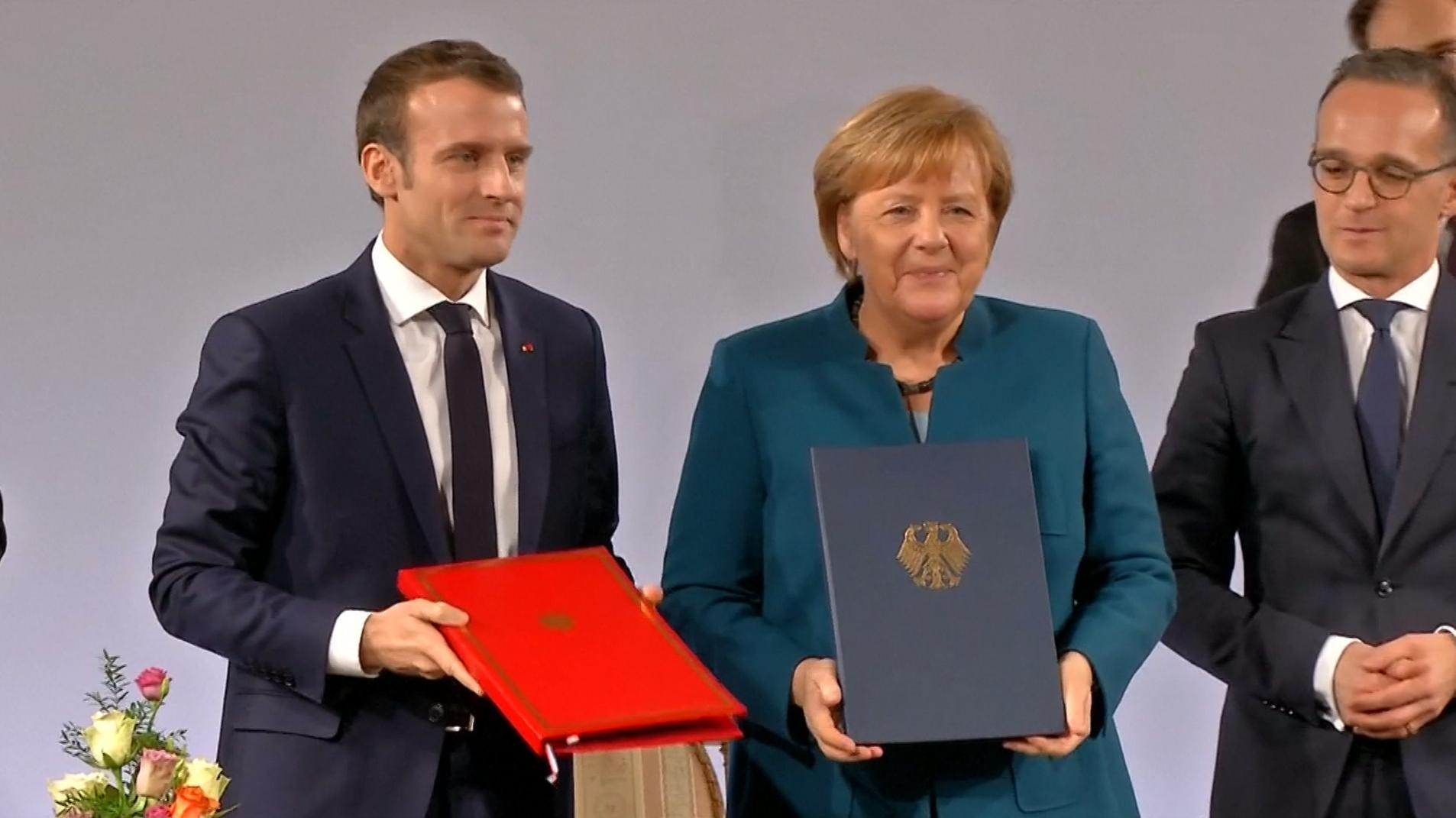 Kanzlerin Merkel und Frankreichs Präsident Macron haben einen neuen Pakt für die deutsch.französische Freundschaft besiegelt.