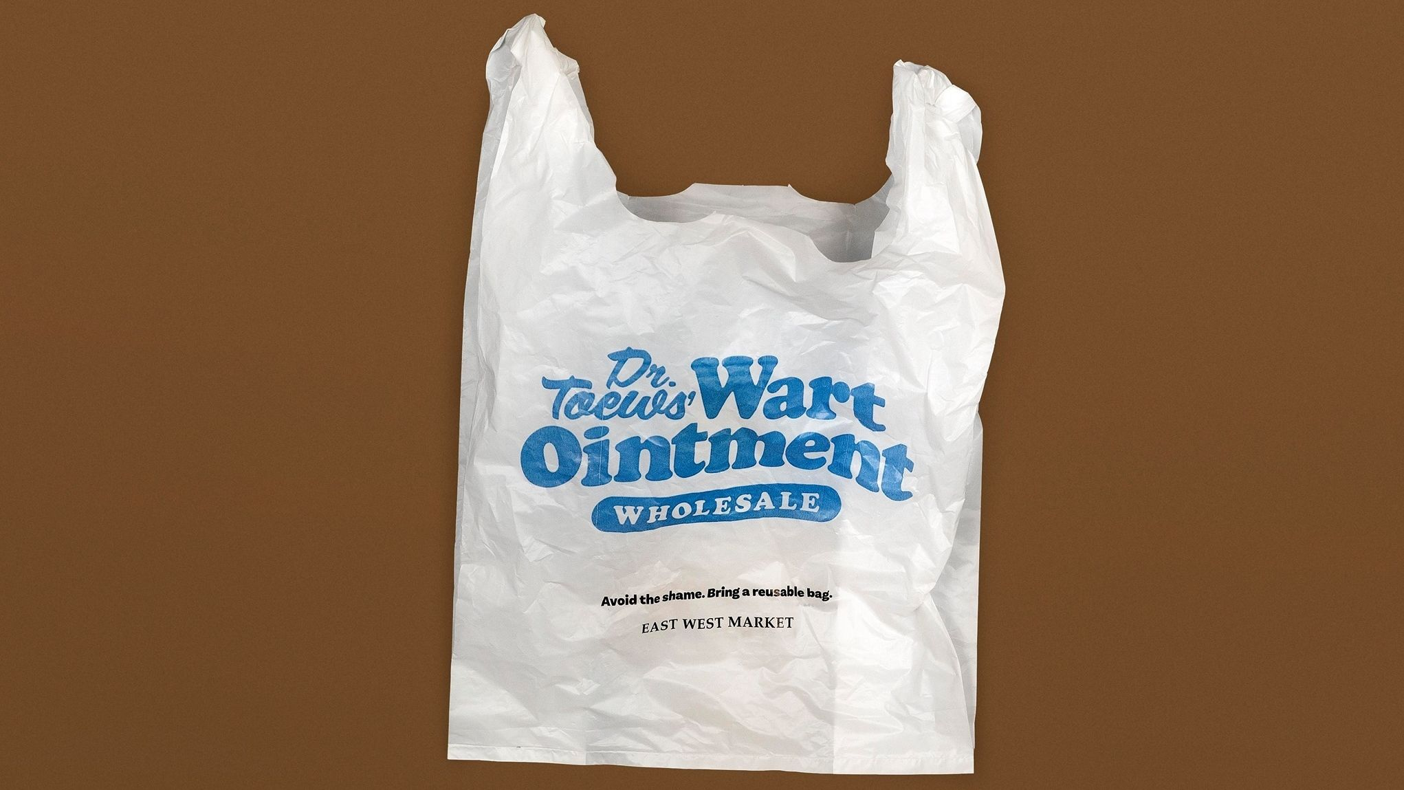 Plastiktüte mit Werbeaufdruck für Warzensalbe.