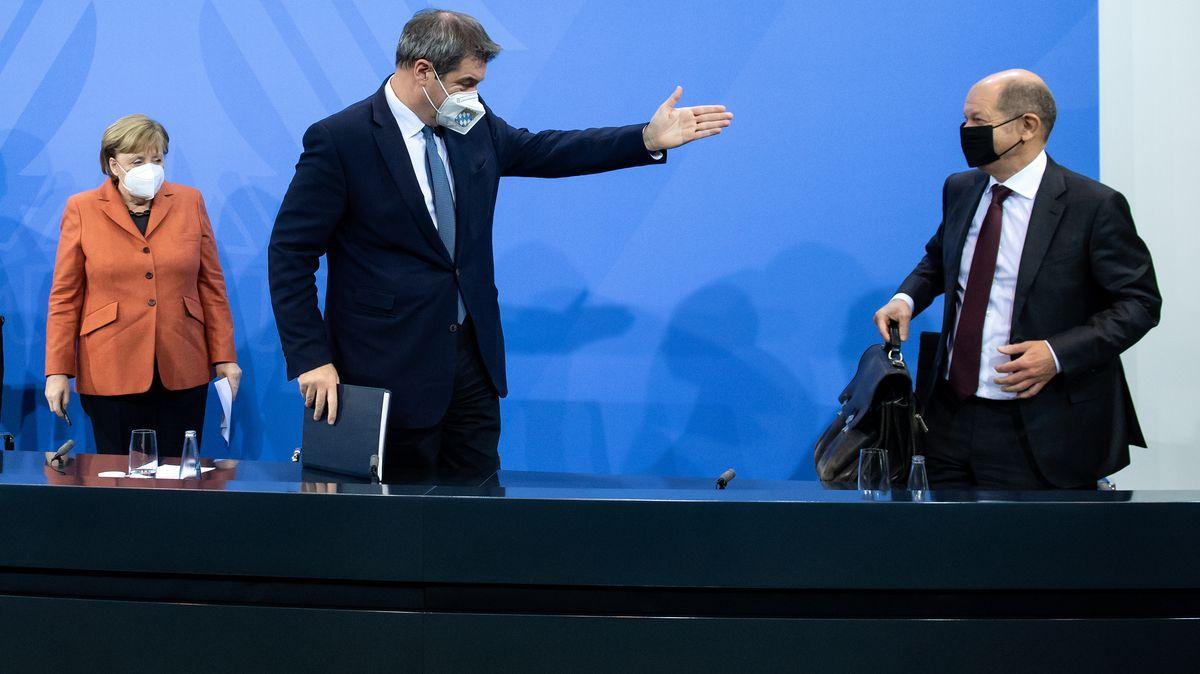Kanzlerin Angela Merkel (CDU), Markus Söder und Olaf Scholz (SPD) auf einer Pressekonferenz am 13.12.2020