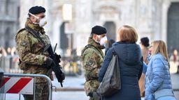 Die Mailänder Kathedrale wird streng bewacht.   Bild:dpa-bildfunk/Claudio Furlan