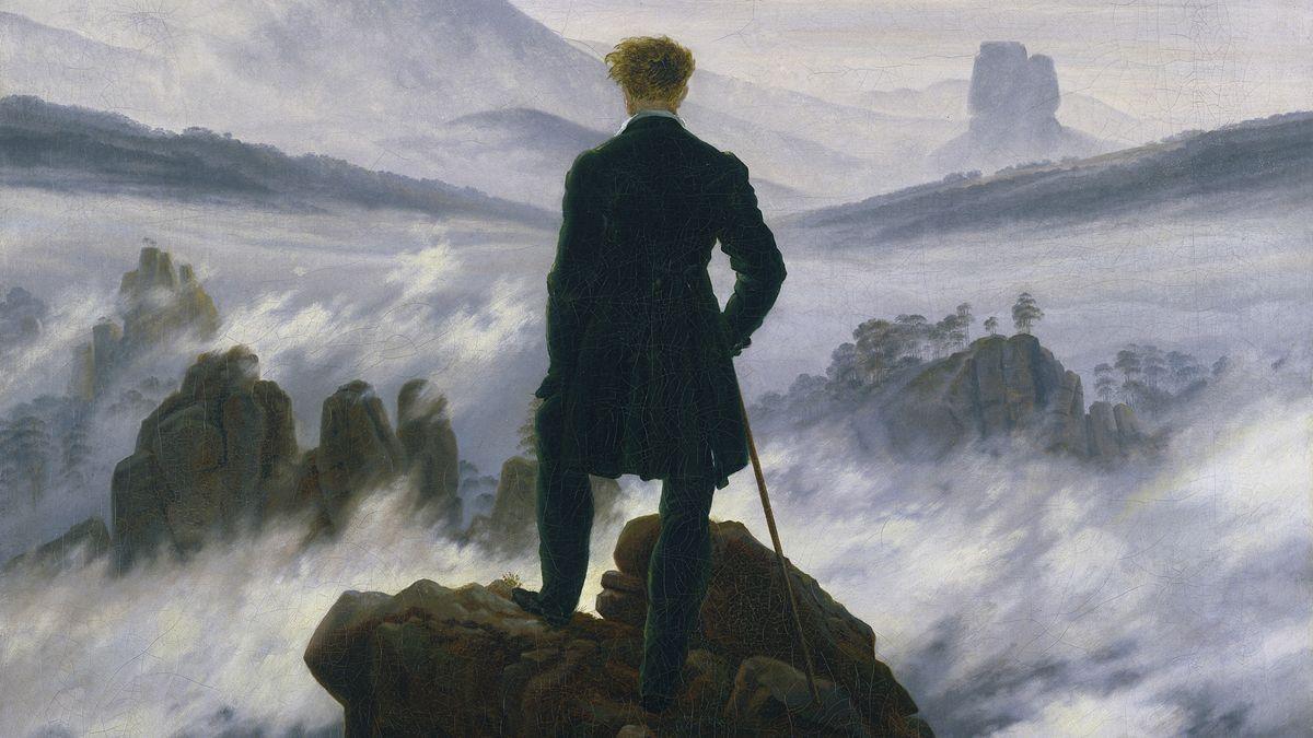 """""""Der Wanderer über dem Nebelmeer"""", Gemälde von Caspar David Friedrich: Ein Mann steht, von hinten gesehen, auf einem Felsvorsprung und blickt in eine von Wolkennebeln durchzogene Gebirgsalandschaft"""