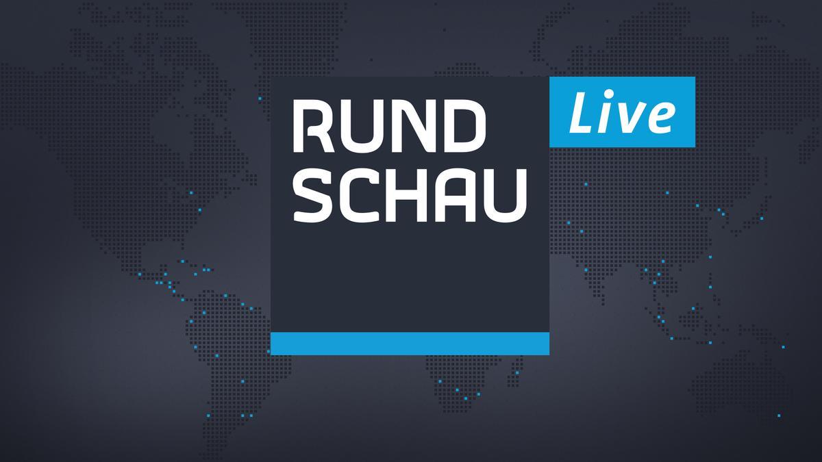 Rundschau-Logo mit Live-Auszeichnung vor Weltkarte