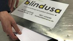 Aktenvernichtung bei Blindusa in Augsburg | Bild:BR/Barbara Leinfelder