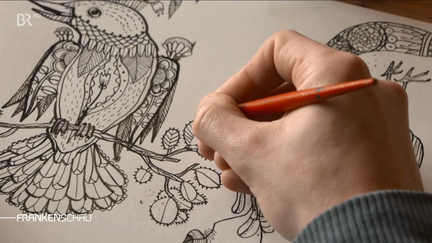 Marco Wagner aus der Rhön fertigt eine Zeichnung an
