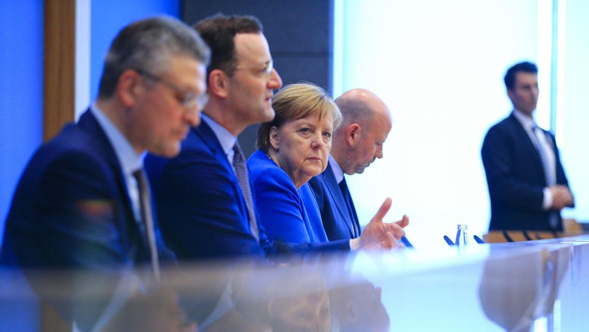Pressekonferenz mit Lothar Wieler, Jens Spahn und Angela Merkel. Fokus auf den düsteren Blick der Bundeskanzlerin