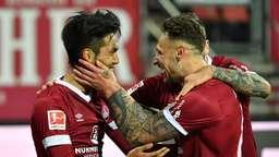 Jubelnde Spieler 1. FC Nürnberg | Bild:picture-alliance/dpa