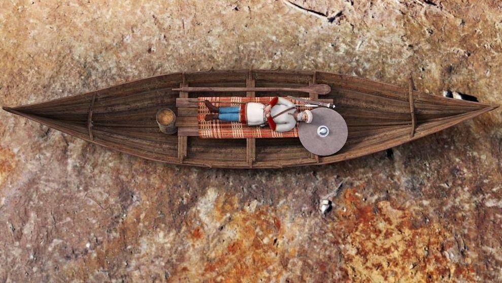 Modellhafte Darstellung der Beerdigung eines Mannes in einem Bootsgrab der Wikingerzeit in Norwegen.