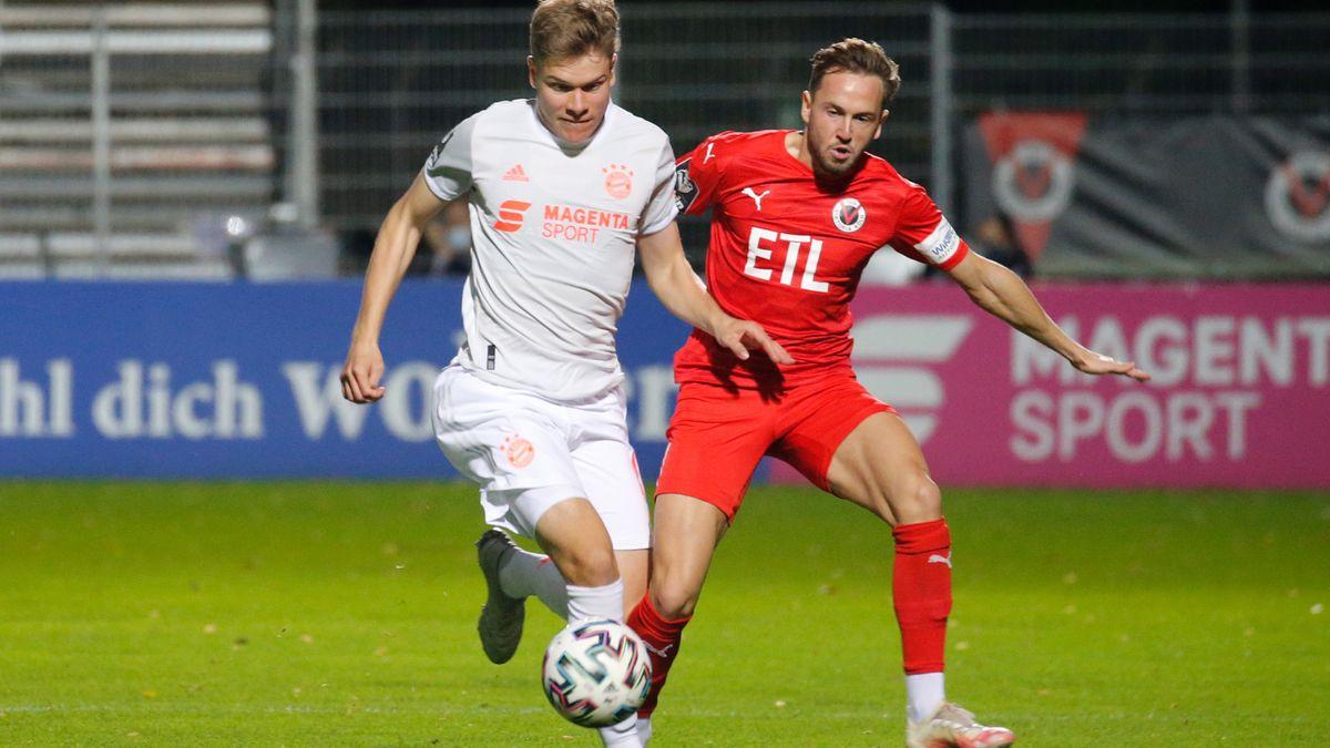 Kilian Senkbeil (FC Bayern Muenchen II) und Lucas Cueto