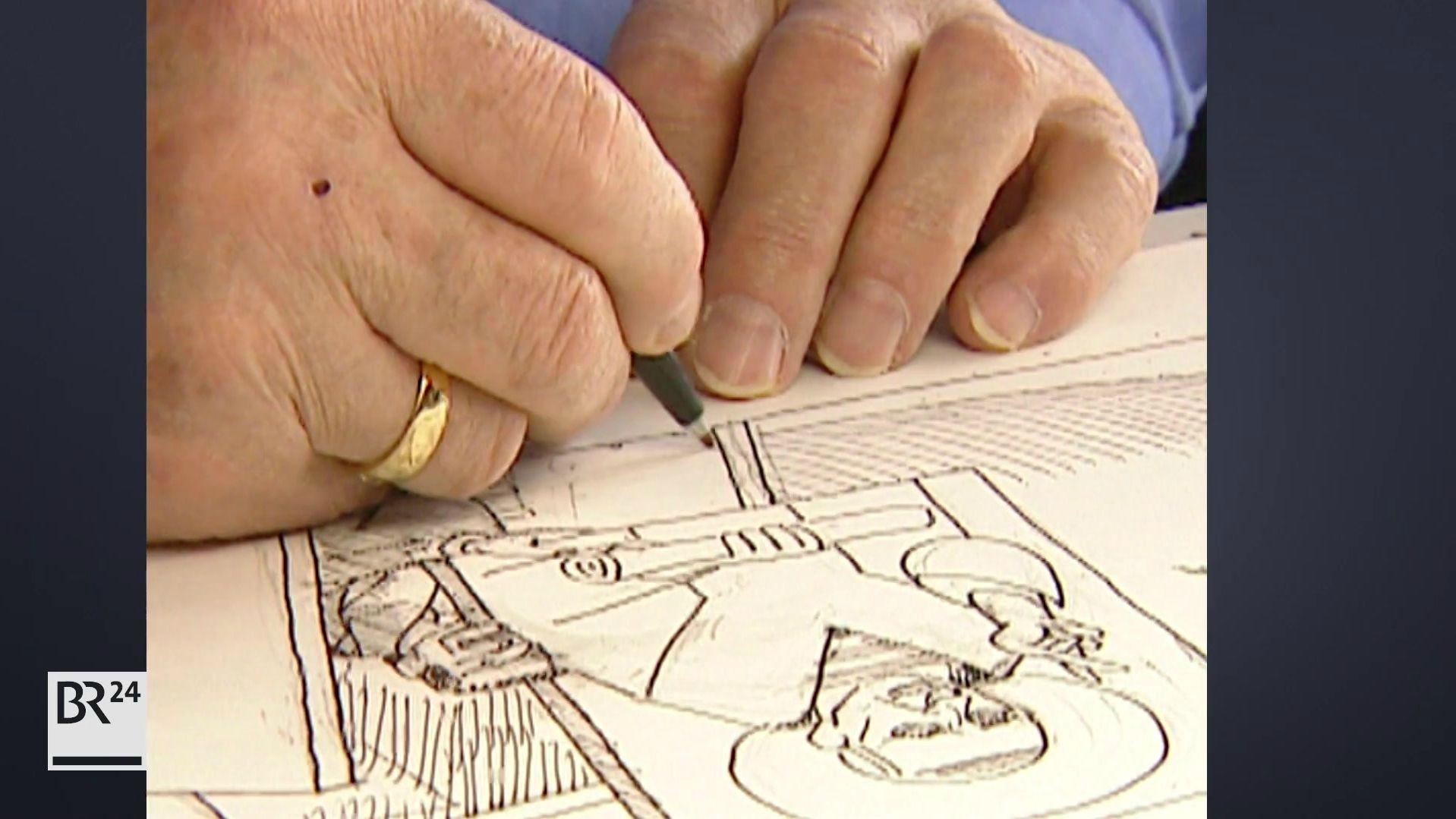 Ernst Maria Lang beim Zeichnen einer Karikatur