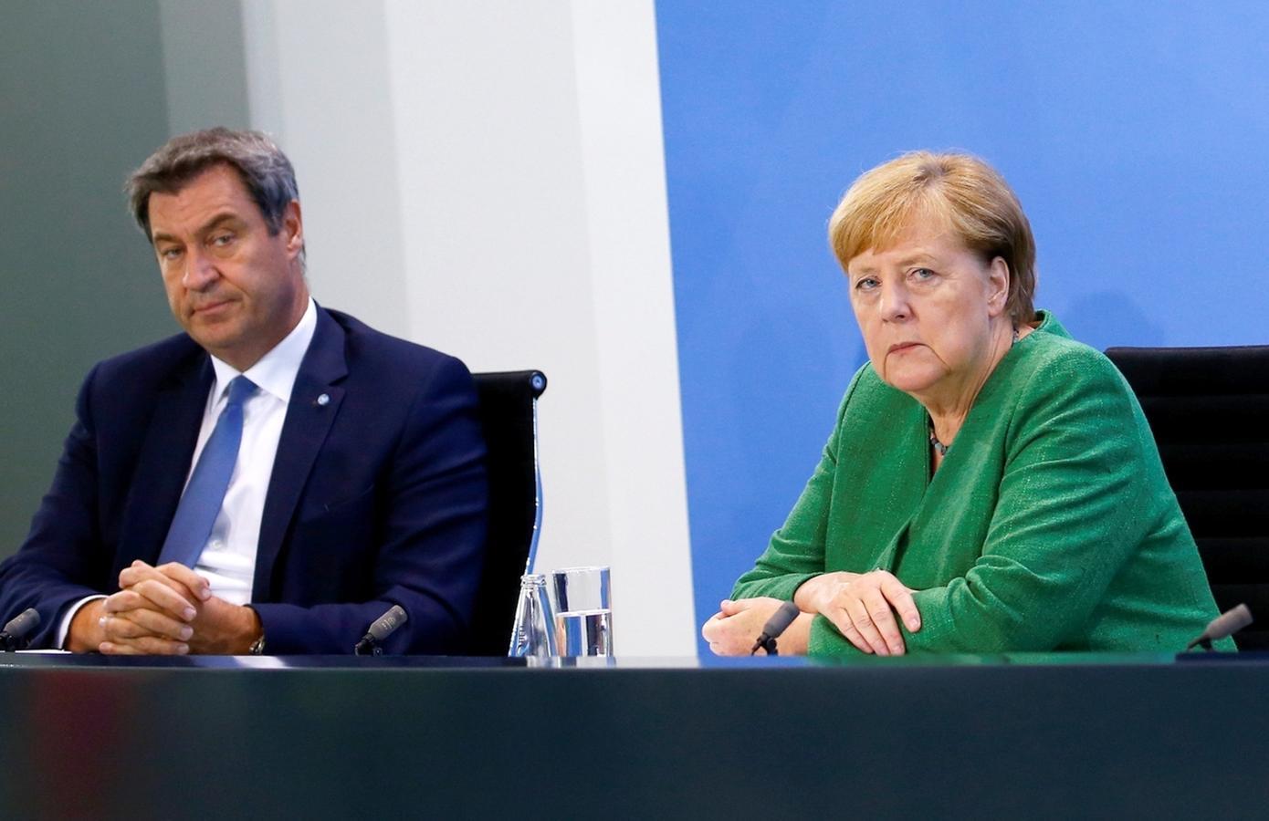 Angela Merkel und Markus Söder stellen Ergebnisse...
