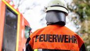 Symbolbild: Ein Feuerwehrmann im Einsatz | Bild:BR/Johanna Schlüter