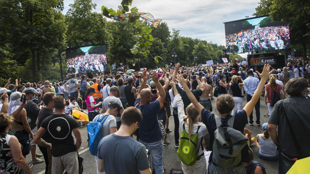 People attend a demonstration under the motto 'The end of pandemic - Liberation day' at Strasse des 17. Juni in Berlin, Germany on August 1, 2020. A mix of Coronavirus Deniers and Right groups called to this demonstration to protest against the government and the current measurements to curb the COVID-19 spreading.