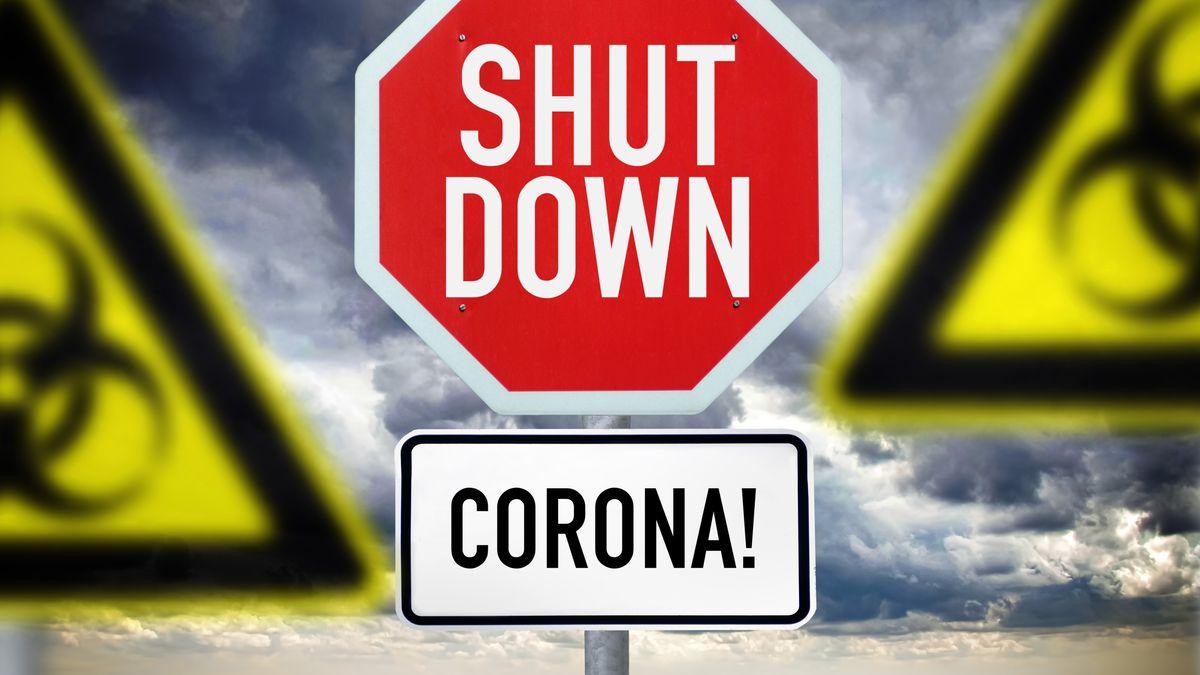 Schild mit der Aufschrift Shutdown und Biogefährdungsschilder
