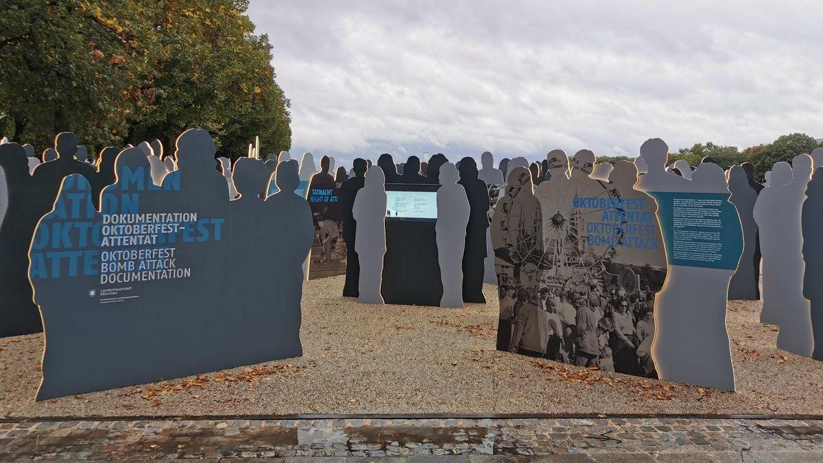 Der neue Erinnerungsort Theresienwiese: Lebensgroße, beleuchtete Silhouetten erinnern an die Opfer und halten digitale Informationen abrufbar.
