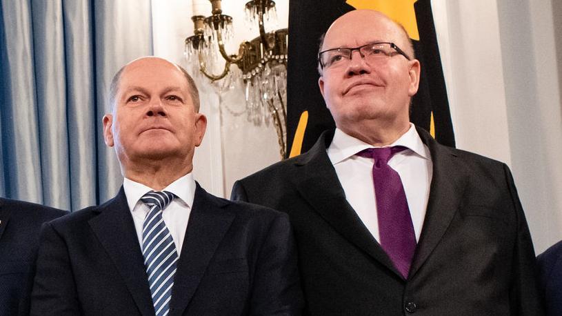 Olaf Scholz, SPD (l.) und Peter Altmaier, CDU (beim Neujahrsempfang 2019 des Bundespräsidenten)